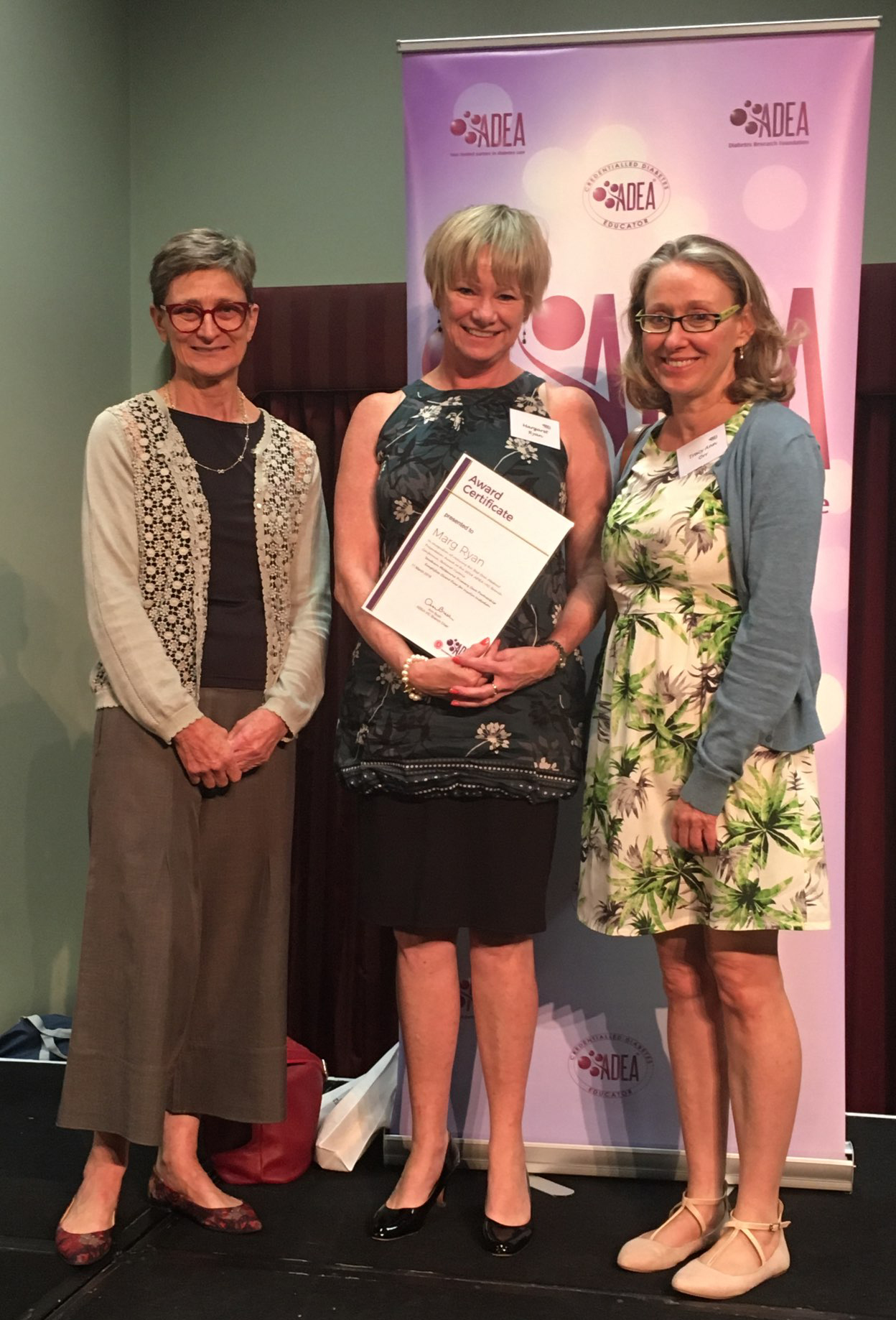 Image shows Joanne Ramadge, Marg Ryan and Tracy Orr with certificate